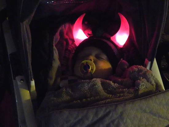 A baby with devil's horns
